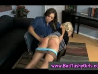 Bad schoolgirl in stockings gets spanked