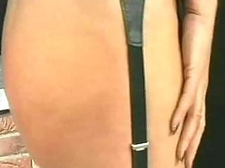 Blond milf slave with bit tits bends over and got spanked on