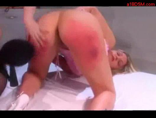 Blonde girl in pink top getting her ass spanked to red by mi