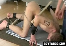 horny chained up hunk getting whipped good and hard
