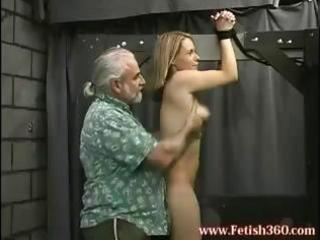 Blonde milf is tied up and gets her ass spanked and nipples tortured