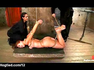bound babe on the floor caned and vibed