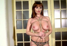 lataya roxxx is a beautiful redheaded milf who likes whips, ropes, and all manner of kinky bondage type stuff. today, though, shes doing more mild -- but still uber-hot -- posing.