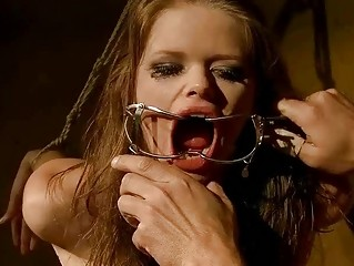 Young girl being painfully punished