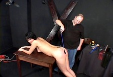dark?haired hottie, bound and spanked by her master